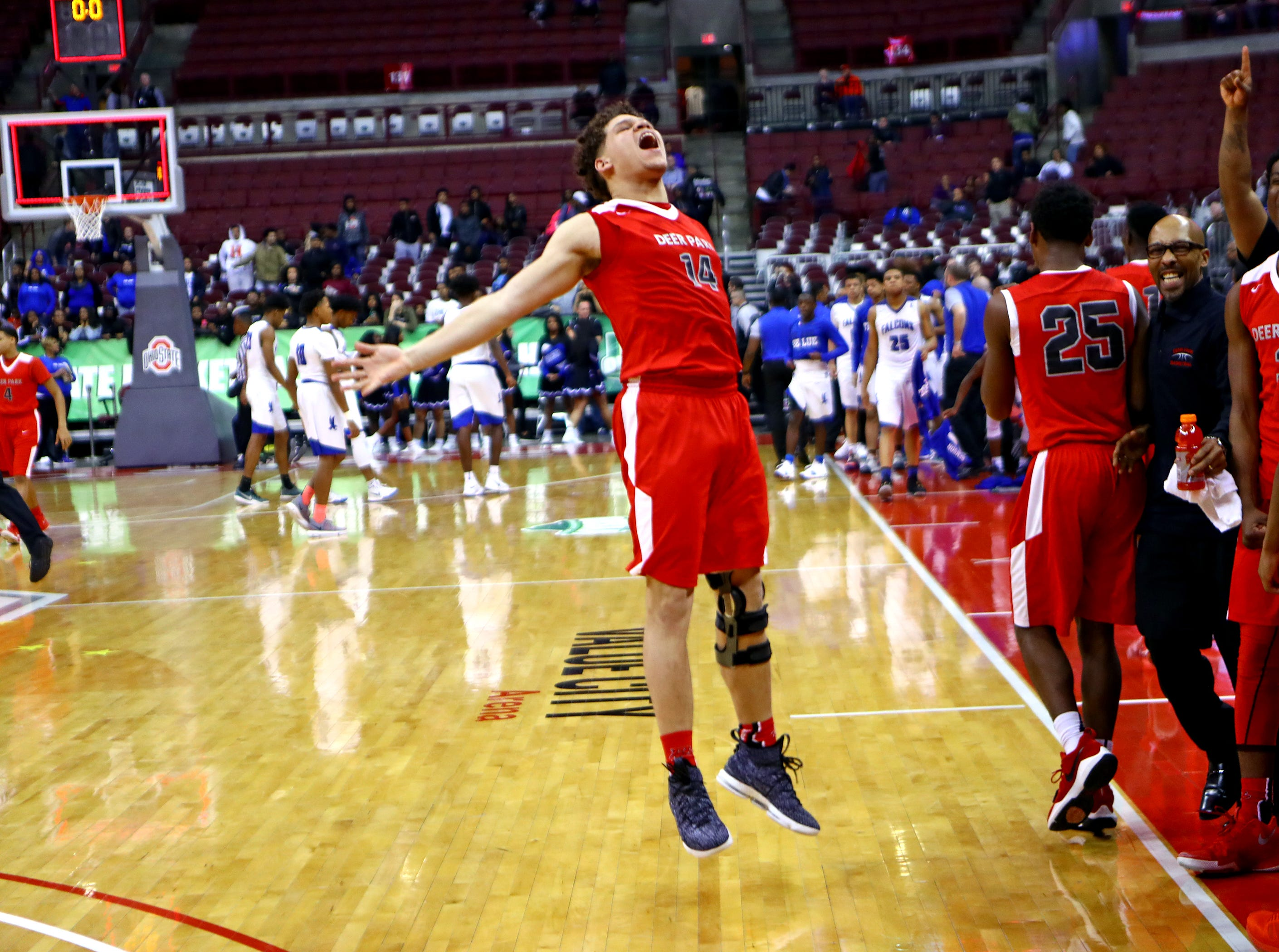 Deer Park center Joseph Hocker celebrates as the clock runs out. Deer Park defeated Cleveland Lutheran East 66-48 and moves on to the Championship game Saturday.