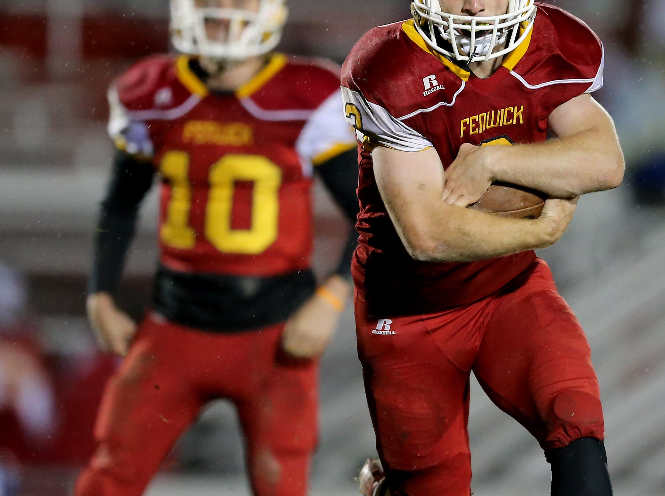 Bishop Fenwick running back Jack Fessler (3) carries the ball in the third quarter during a high school football game between Purcell Marian and Bishop Fenwick, Friday, Oct. 12, 2018, at Bishop Fenwick High School in Middletown, Ohio.