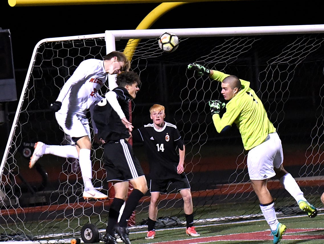 Anderson's Jason Moore (25) drives a header into the net for the overtime game winning goal for the Redskins, October 25, 2018.