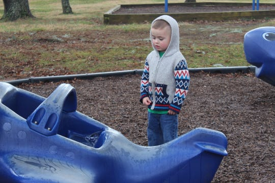 Alexander Taylor, 4, plays at his favorite playground at Barbara E. Johnson Park next to Outlaw Field.