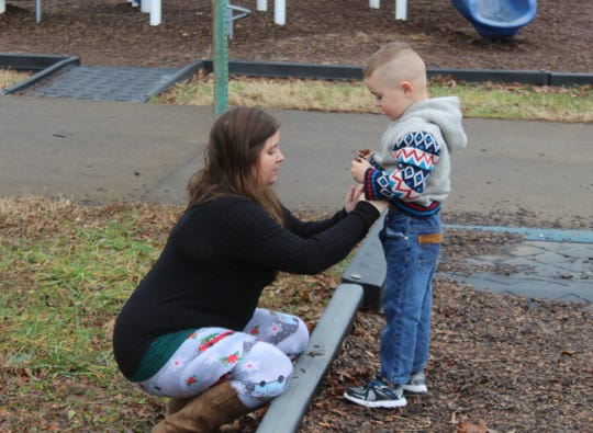 Jennifer Taylor spends time with her son Alexander at his favorite playground at Barbara E. Johnson Park next to Outlaw Field.