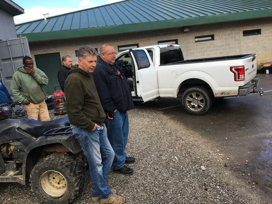 Otis Kelly, left, chats with Houston County Sheriff Kevin Sugg as they lean against a stolen four-wheeler recovered Friday morning.