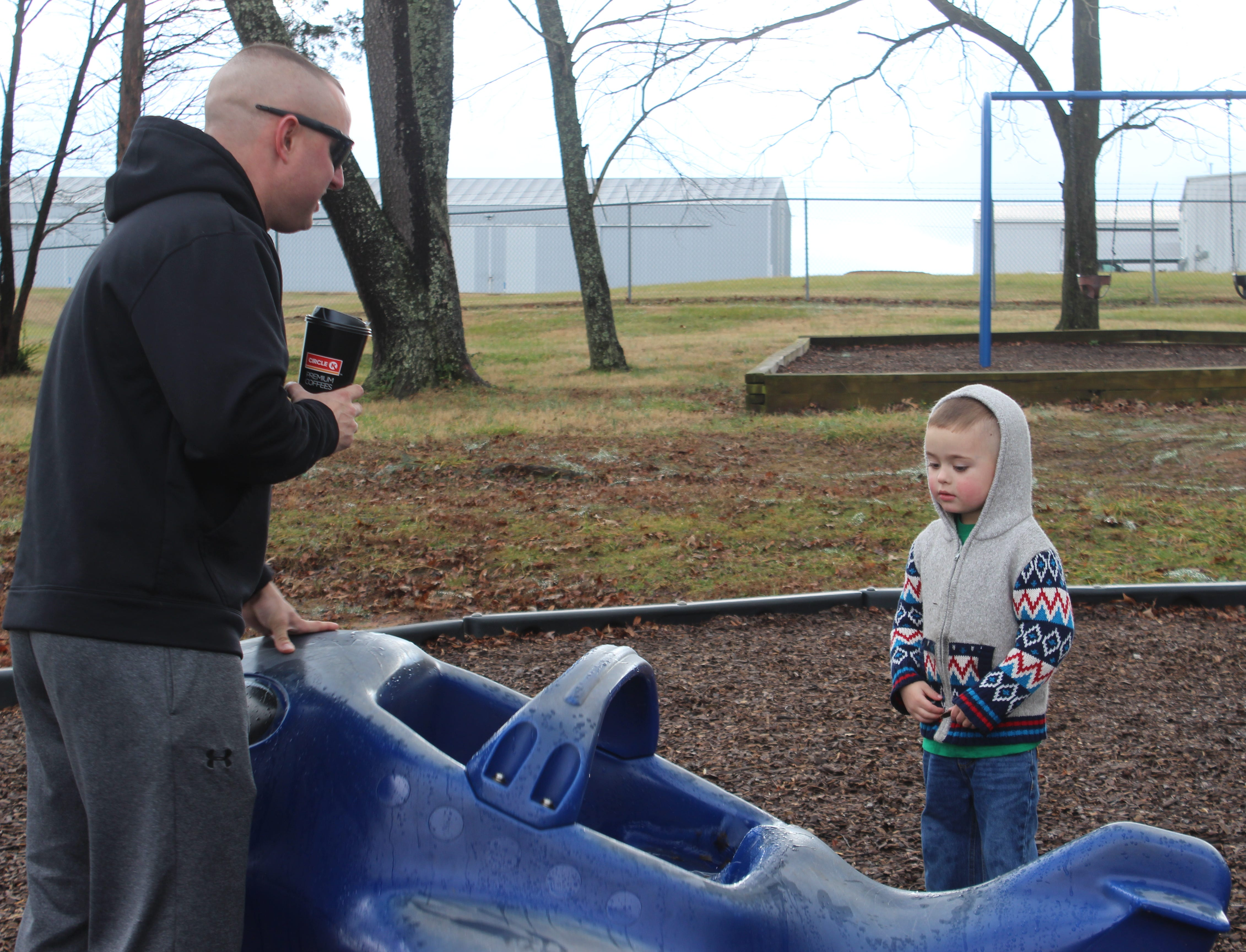 David Taylor spends time with his son Alexander at his favorite playground at Barbara E. Johnson Park next to Outlaw Field.