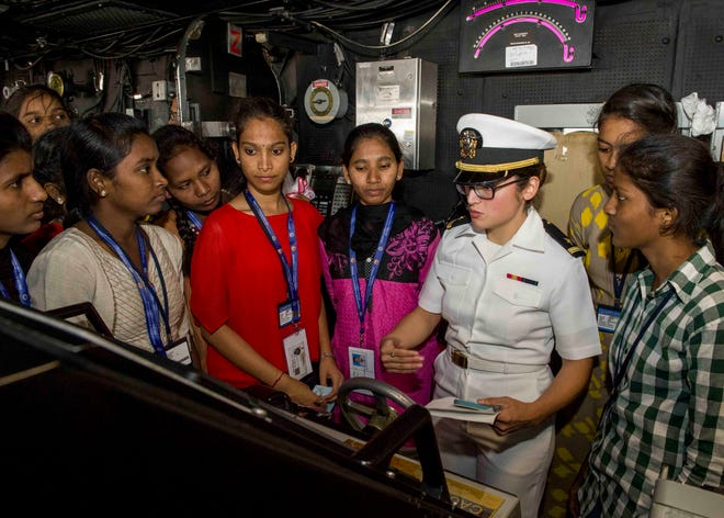 Ensign Giovanna Rodriguez, of North Plainfield, gives a tour of the pilothouse aboard the San Antonio-class amphibious transport dock ship USS Anchorage (LPD 23) to female students from St. Joseph's College during a port visit to Visakhapatnam, India, while on a deployment of the Essex Amphibious Ready Group (ARG) and 13th Marine Expeditionary Unit.