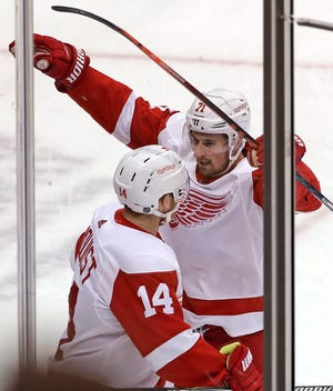 Detroit forward Dylan Larkin (71) celebrates his goal with Gustav Nyquist (14) during the first period against the Pittsburgh Penguins in Pittsburgh on Thursday. the goal was Larkin's 16th of the season.