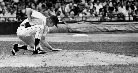 Mark Fidrych smooths the mound at Tiger Stadium in 1976.