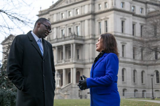 Michigan Lt. Governor Elect Garlin Gilchrist ll, left, speaks with Michigan Governor Elect Gretchen Whitmer, outside of the Lansing State Capitol building Thursday, Dec. 27, 2018.