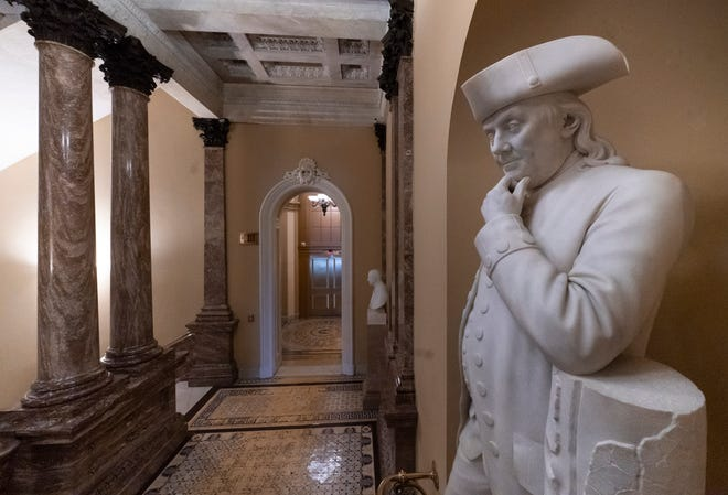 A statue of Benjamin Franklin is seen in an empty corridor outside the Senate at the Capitol in Washington, Thursday, Dec. 27, 2018, during a partial government shutdown.