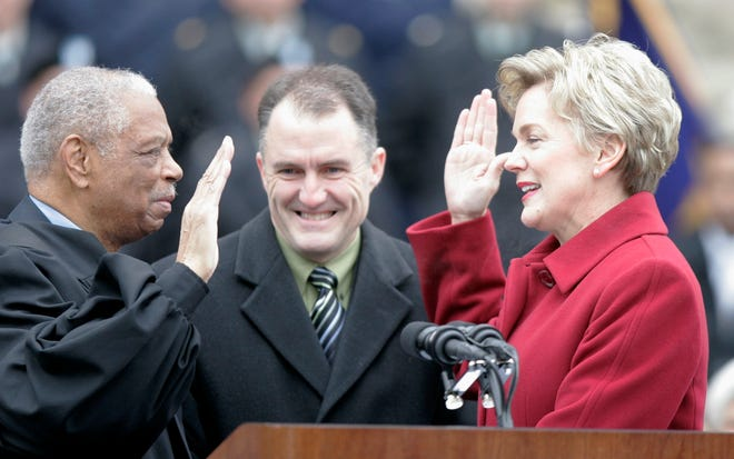 Then-Gov. Jennifer Granholm takes her oath of office on Jan. 1, 2007, during inauguration ceremonies at the Capitol in Lansing.  Judge Damon Keith, left, administered the oath and first gentleman Dan Mulhern held the Bible.