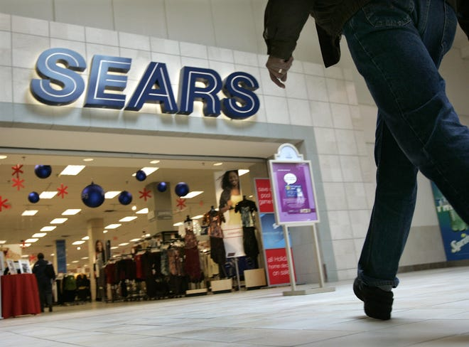 In a Dec. 5, 2005 file photo, a shopper heads into the Sears department store at the Richmond Towne Center mall in Richmond Heights, Ohio. Sears Holdings Inc.'s statement Monday, Feb. 13, 2017, said that Sears and Kmart have evicted some Trump-branded items from their online stores, but won't specify how many and emphasize that hundreds of products are still available through its third-party online marketplace.  (AP Photo/Amy Sancetta, File)