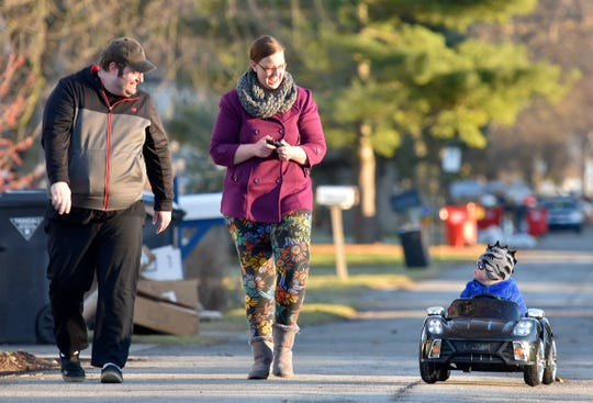 Curtis Crowe and his wife, Melissa, walk with their one-year-old son, Gabriel, as he rides in his remote-controlled, electric car on Beamer St., near Crocker and Metro Parkway in Harrison Township on Friday afternoon, December 28, 2018. Gabriel received the car from his aunt for a Christmas/birthday present when he turned one, Thursday. He also started treatment for Acute Lymphoblastic infant Leukemia (ALL) in October.
