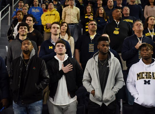 Shea Patterson and Van Jefferson (gray jacket) stand for the national anthem at the Crisler Center when they visited Michigan in December 2017.