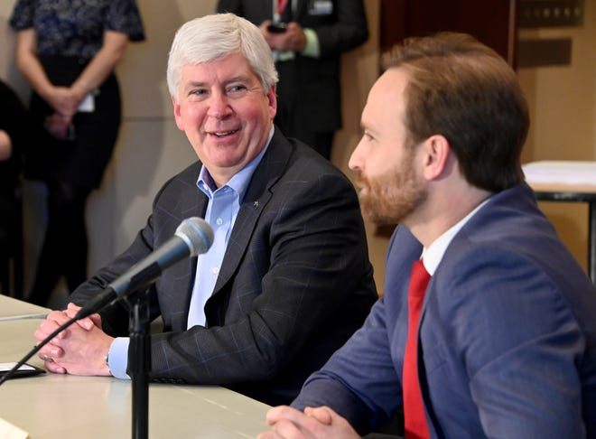 Michigan Gov. Rick Snyder smiles at Lt. Gov. Brian Calley at their end-of-the year roundtable with the media in the Romney Building in Lansing on Dec. 11.