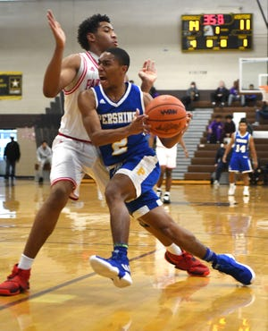 Detroit Pershing's Emmanuel Williams had 12 points and seven steals in a 58-52 win over Detroit University Prep on Friday.