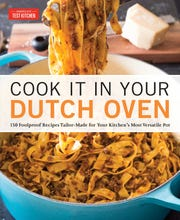 "This image provided by America's Test Kitchen in December 2018 shows the cover for the book ""Cook It In Your Dutch Oven."" It includes a recipe for Chicken Pot Pie. (America's Test Kitchen via AP)"