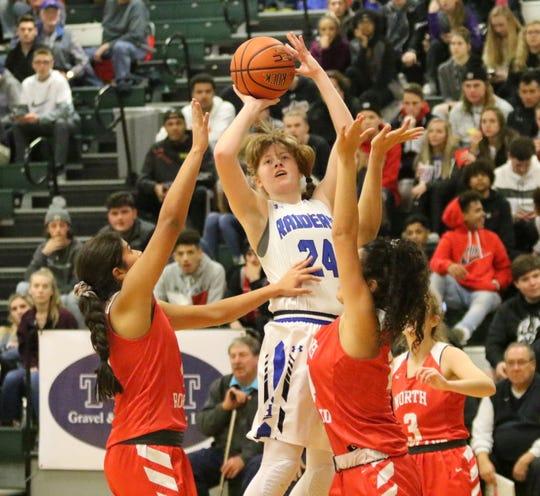 Jillian Casey of Horseheads puts up a shot in between three North Rockland players Dec. 27, 2018 at the Josh Palmer Fund Elmira Holiday Inn Classic at Elmira High School.