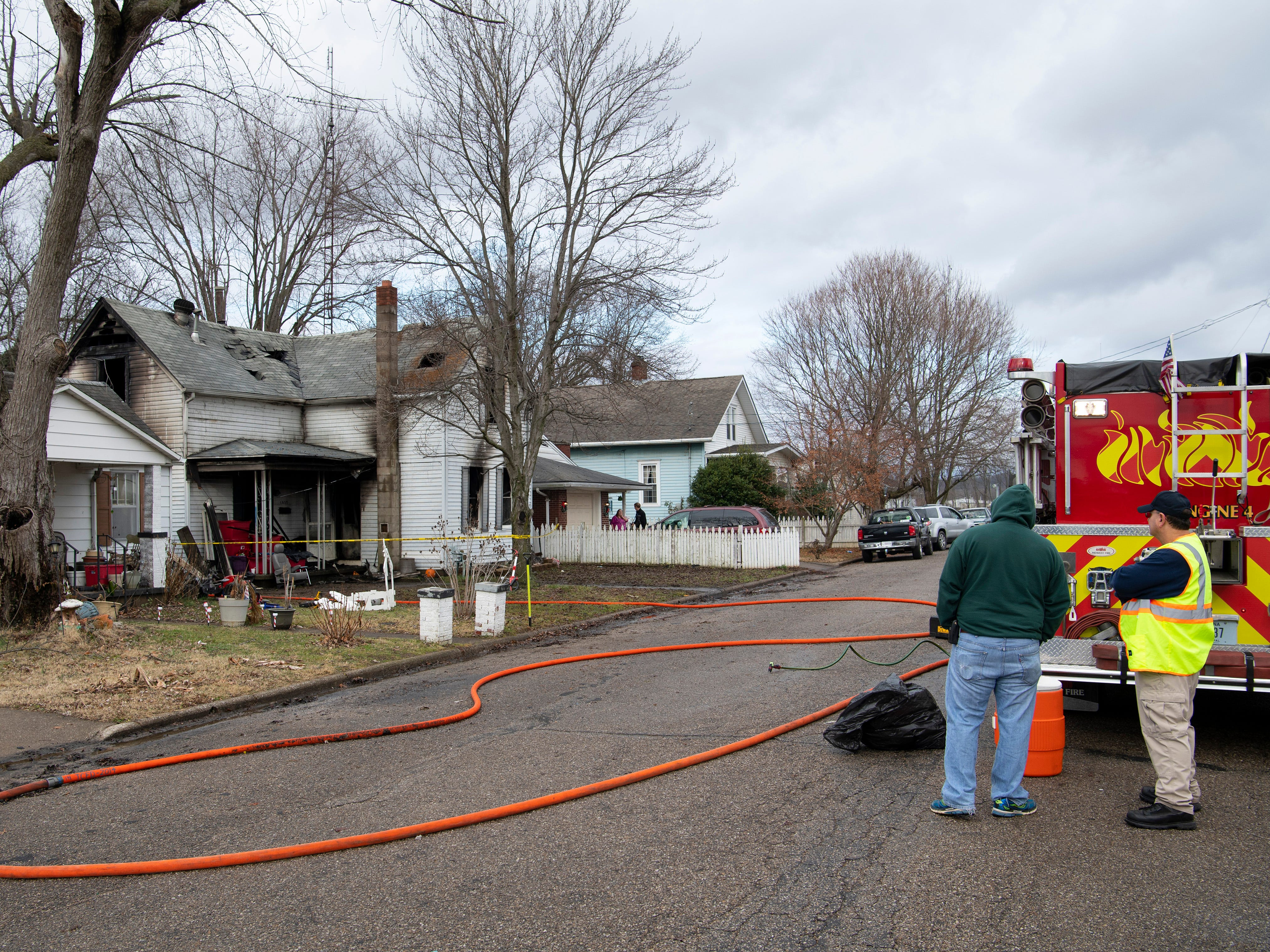 The investigation continues at a home at 1027 15th Street in Tell City, Ind., Friday morning. An early morning fire took the lives of three children in the home. Their mother and two other siblings escaped the blaze with non life-threatening injuries.