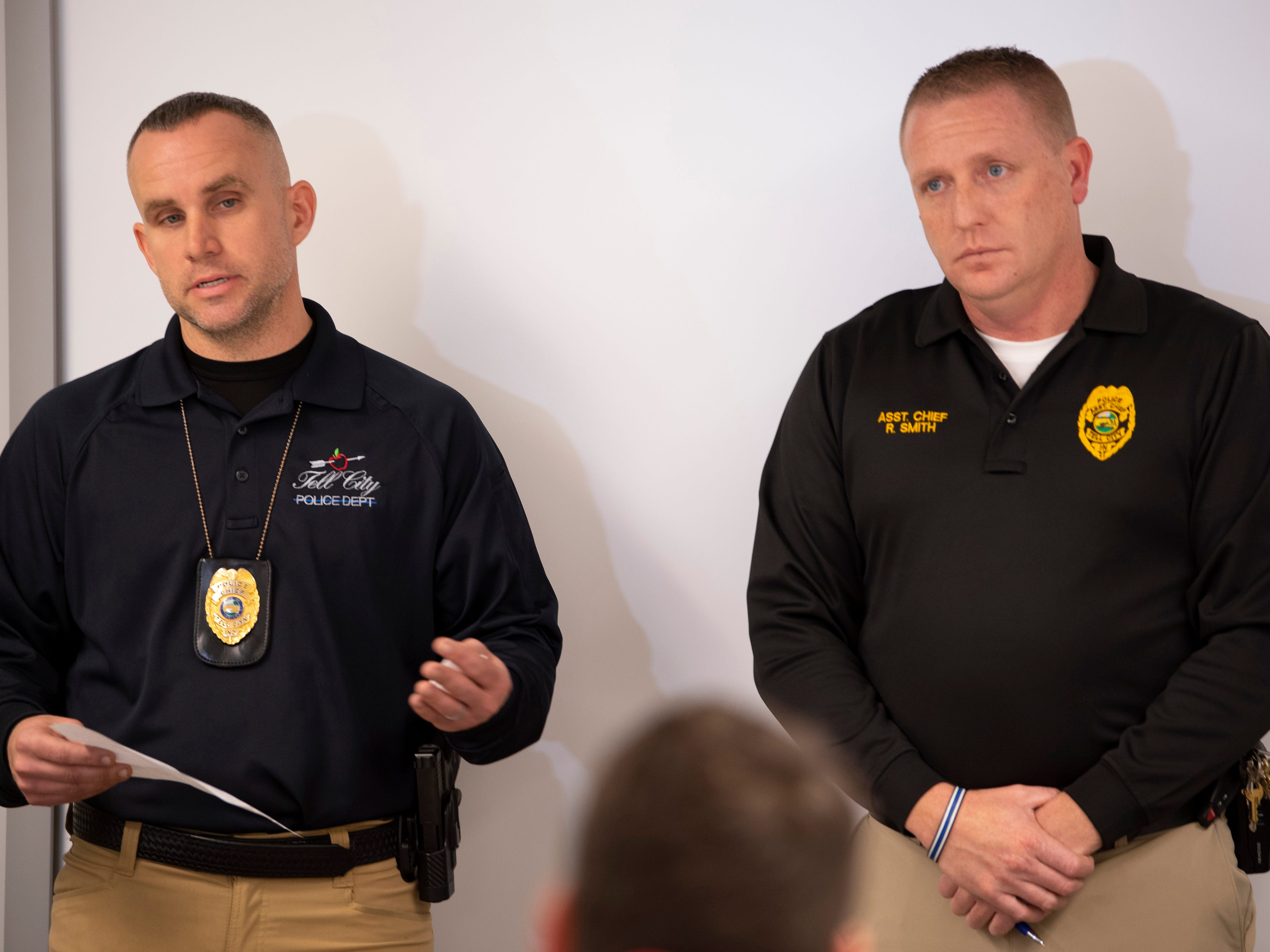 Tell City Police Chief Derrick Lawalin, left, and Asst. Police Chief Roger Smith field questions late Friday morning from the media at a press conference concerning three children who died in a house fire early Friday morning.