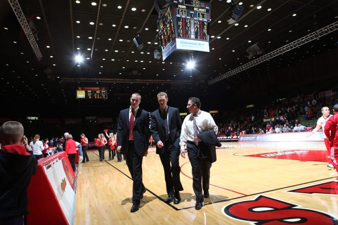 Former Miami of Ohio assistant Todd Lickliter (right) walks off the court at Millett Hall following the RedHawks' 66-61 win over Belmont on Dec. 17, 2011.