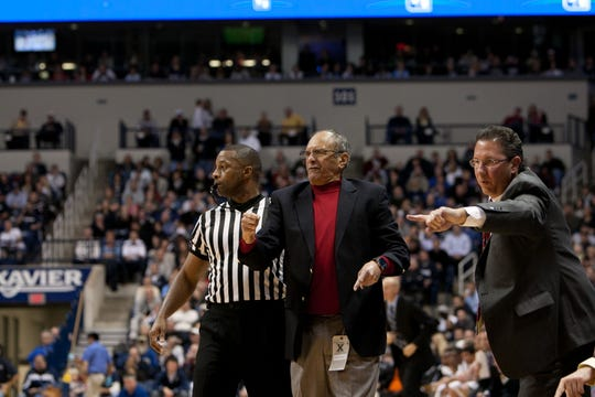 Miami of Ohio head coach Charlie Coles (middle) and assistant Todd Lickliter (right) shout orders from the sideline during a RedHawks' game at Xavier on Nov. 18, 2011.