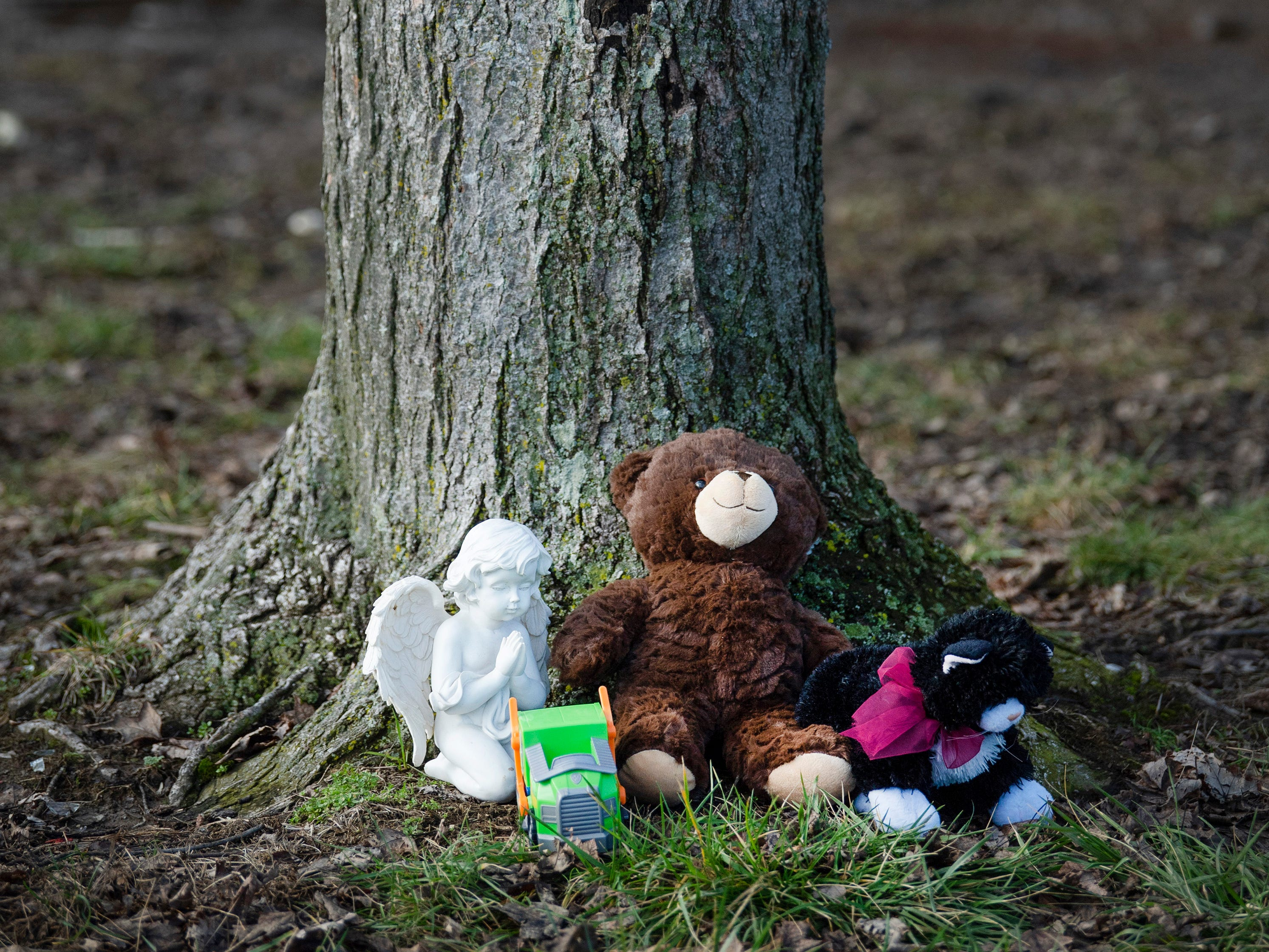 A small memorial below the police tape was started outside the home where three children were killed by fire early Friday morning. Danielle Plock Sims, 11, Thomas Plock Sims, 6, and Roseanna Plock Sims, 3, were all siblings. Their mother, Selina Applegate, and two of her other children escaped with non life-threatening injuries.