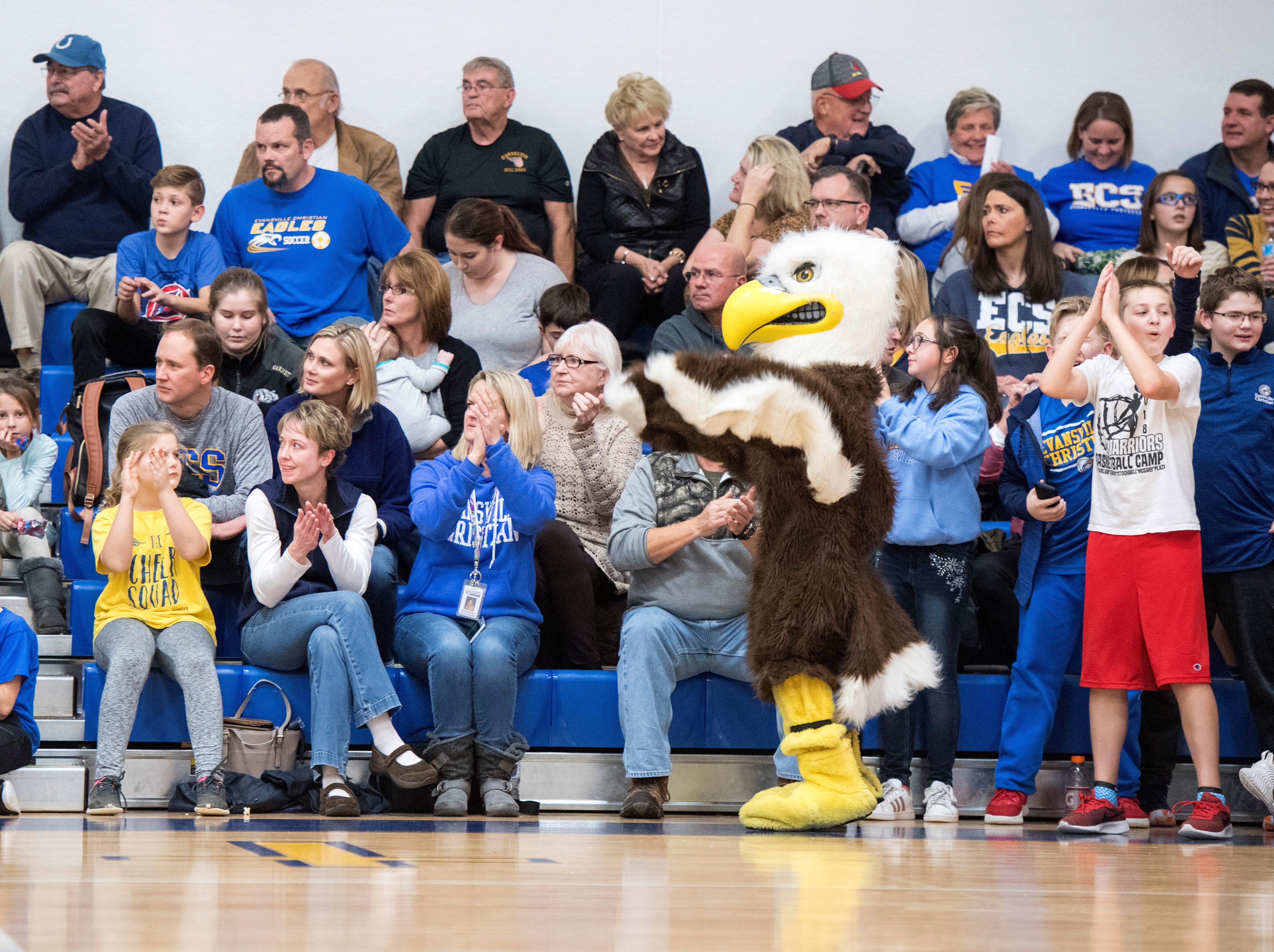 Fans cheer on the Evansville Christian School Eagles while the boys basketball team takes on the Cannelton Bulldogs in schools first-ever home game Friday, Dec. 14, 2018.