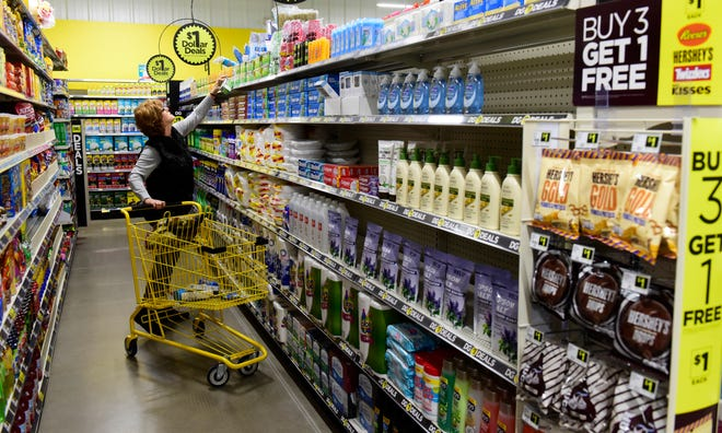 Dawn Mora of Fostoria shops at a new Dollar General at 3147 NE Catawba Rd. in Port Clinton.