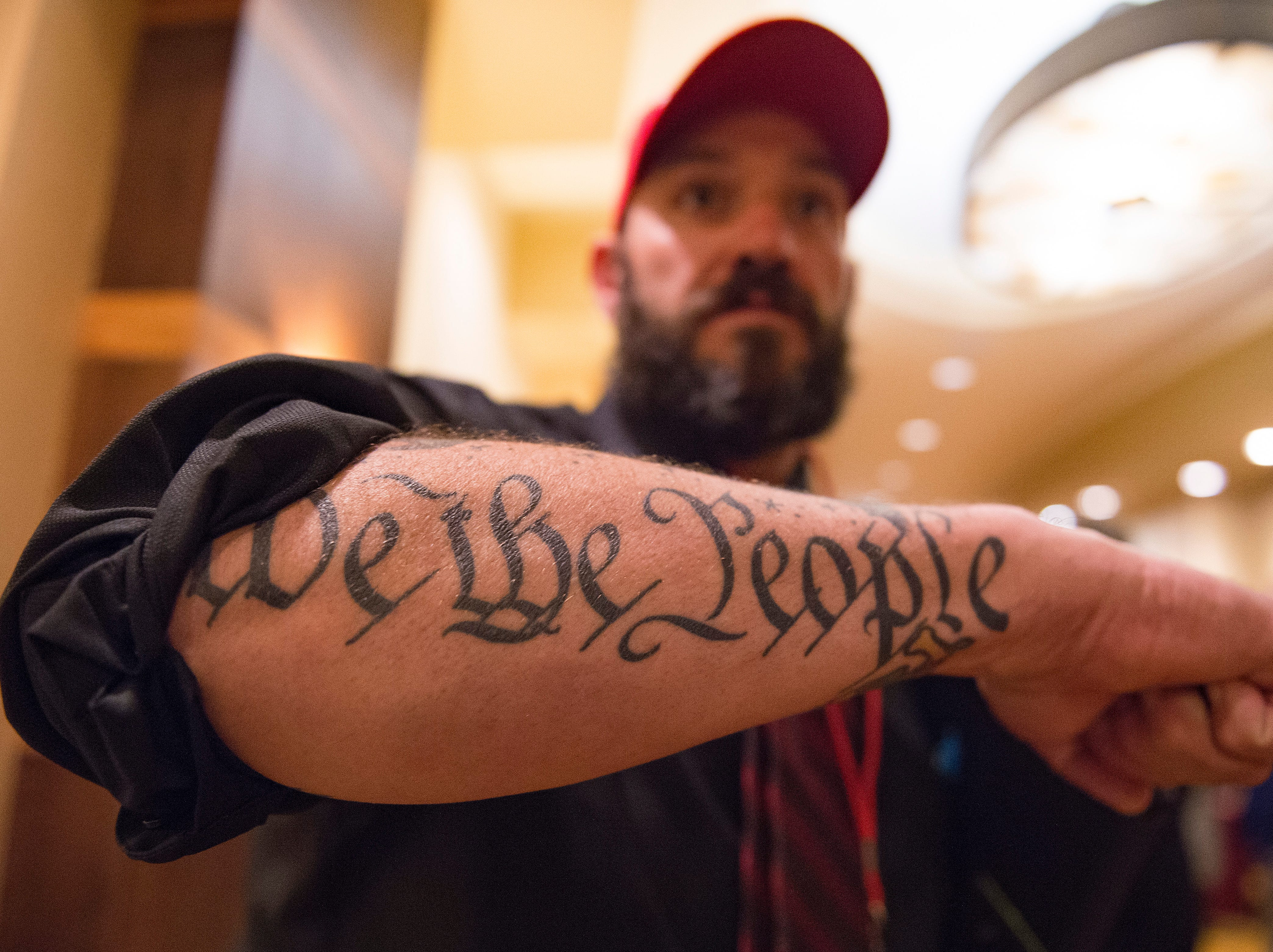 Ty Winter shows off a tattoo inspired by the United States Constitution during a Colorado GOP watch party at the Denver Marriott South at Park Meadows in Lone Tree on Election Day, Tuesday, November 6, 2018.