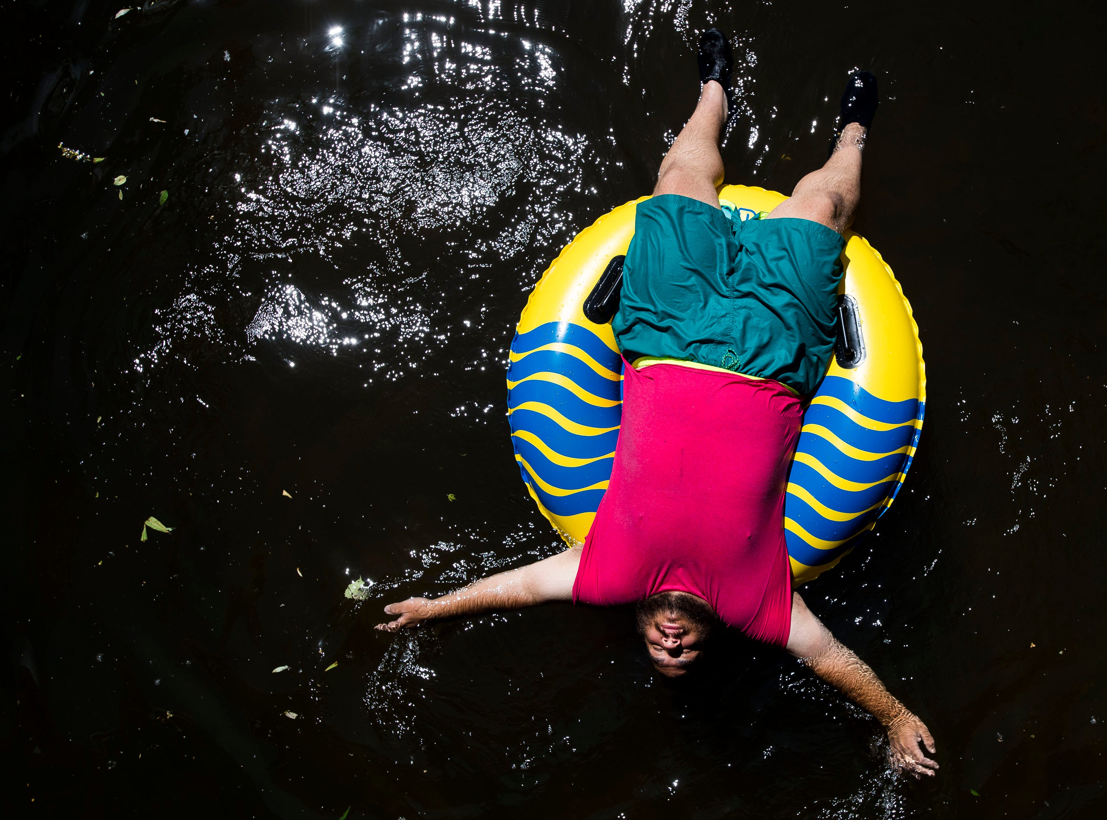 Antonio Diaz casually floats down the Cache La Poudre river on an innertube to stay cool on an especially hot summer day on Thursday, June 28, 2018, in Fort Collins, Colo. The high temperature for the day came in at 101 degree, breaking the previous record for June 28 of 97 degrees, set in 1898.