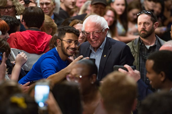 U.S. Sen. Bernie Sanders takes photos with supporters as he campaigns for Democratic candidate for Colorado Governor Jared Polis during a rally at the Lory Student Center at CSU on Wednesday, October 24, 2018.