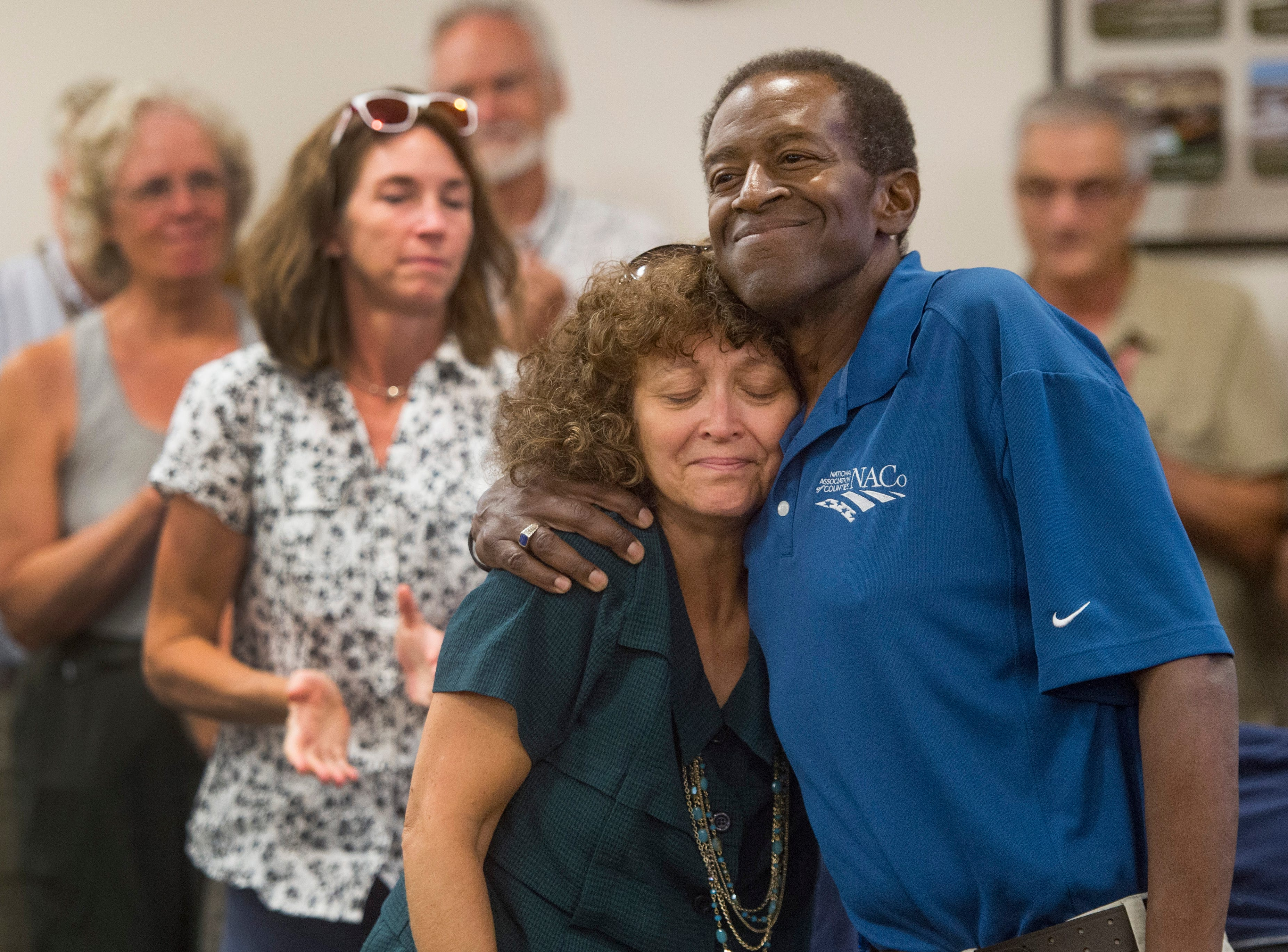 County Commissioner Lew Gaiter III hugs his wife Jeannette after speaking to a packed crowd of friends and colleagues during a gathering to celebrate his life at the Larimer County Courthouse on Wednesday, August 15, 2018. Gaiter III was given six to 12 weeks to live after the cancer he has had for nearly a decade began to take its toll earlier this month.