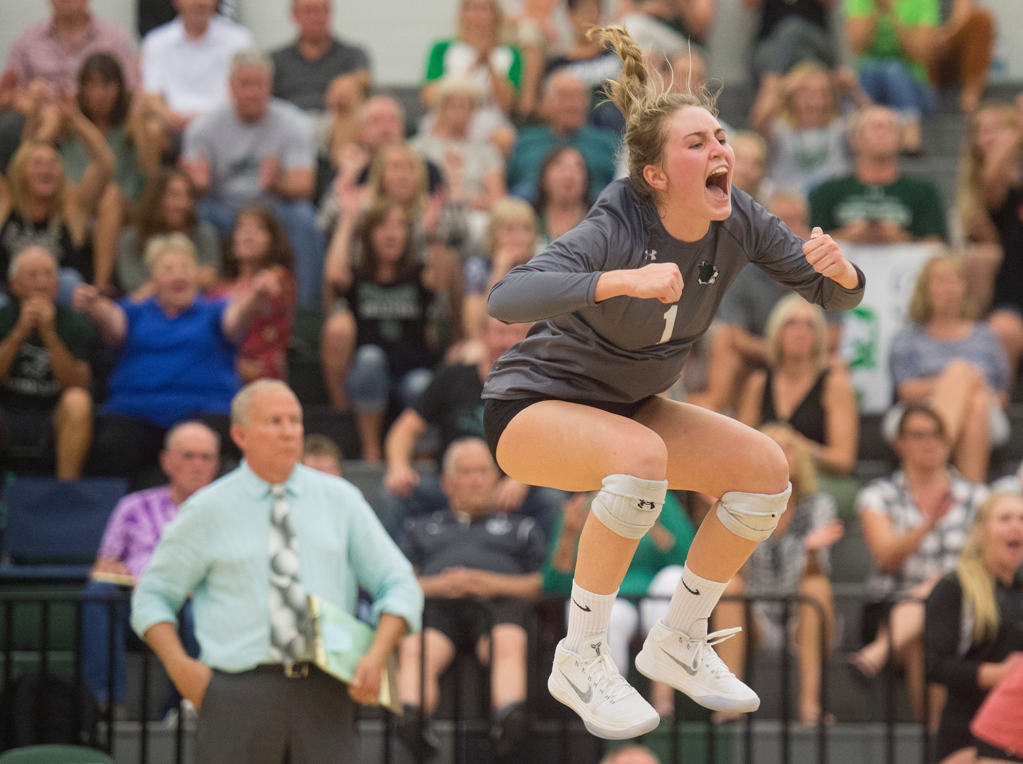Fossil Ridge senior Charlie Durbin jumps in the air after the SaberCats make a play during a game against Fort Collins High School on Tuesday, September 12, 2018. The SaberCats won 3-1.