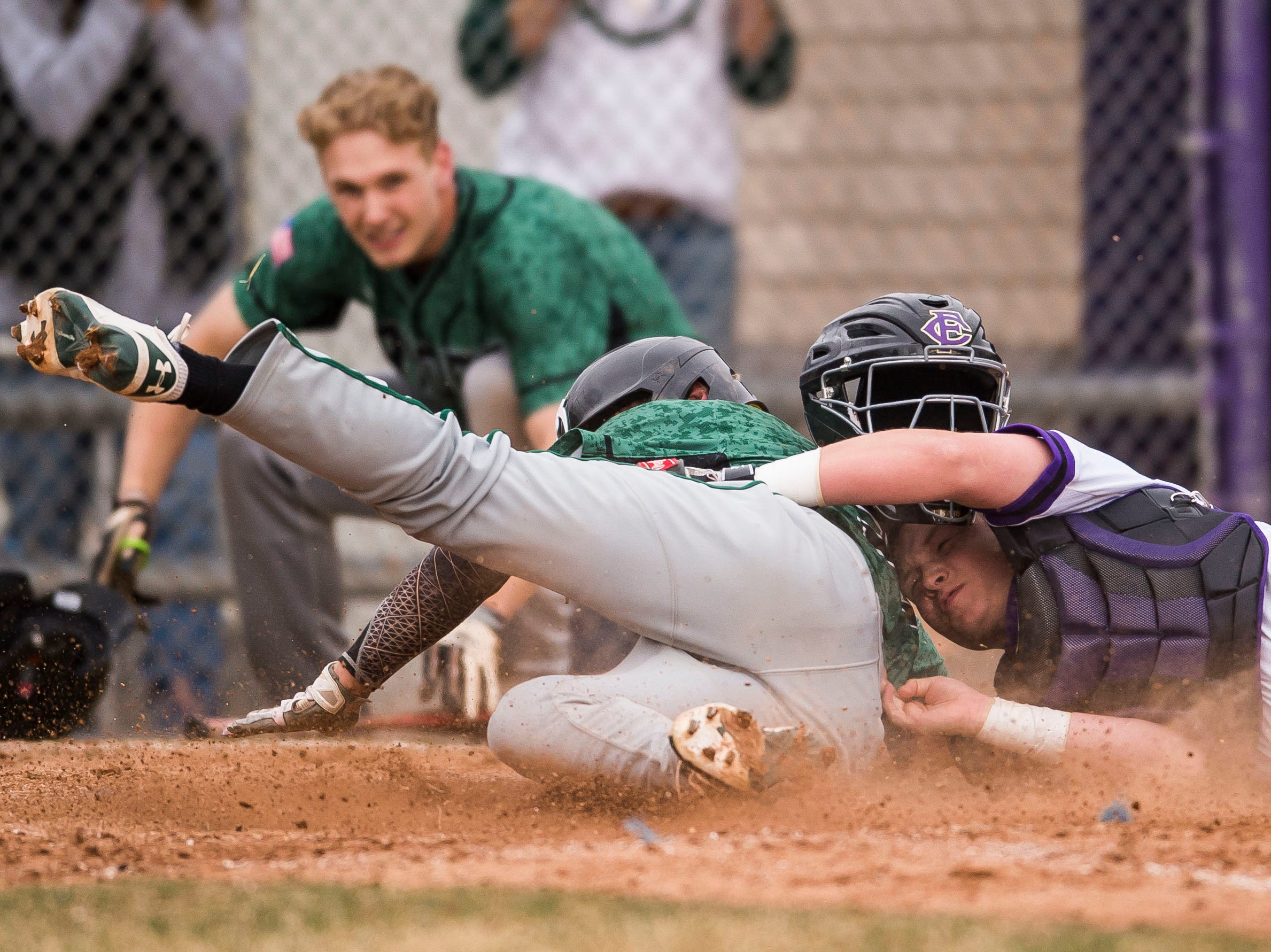 Fort Collins High School sophomore catcher Diego Aragon (5) tags out Fossil Ridge High School runner Casey Knutsen (32) at home to close out a 1-0 win on Thursday, April 5, 2018, at Fort Collins High School in Fort Collins, Colo.