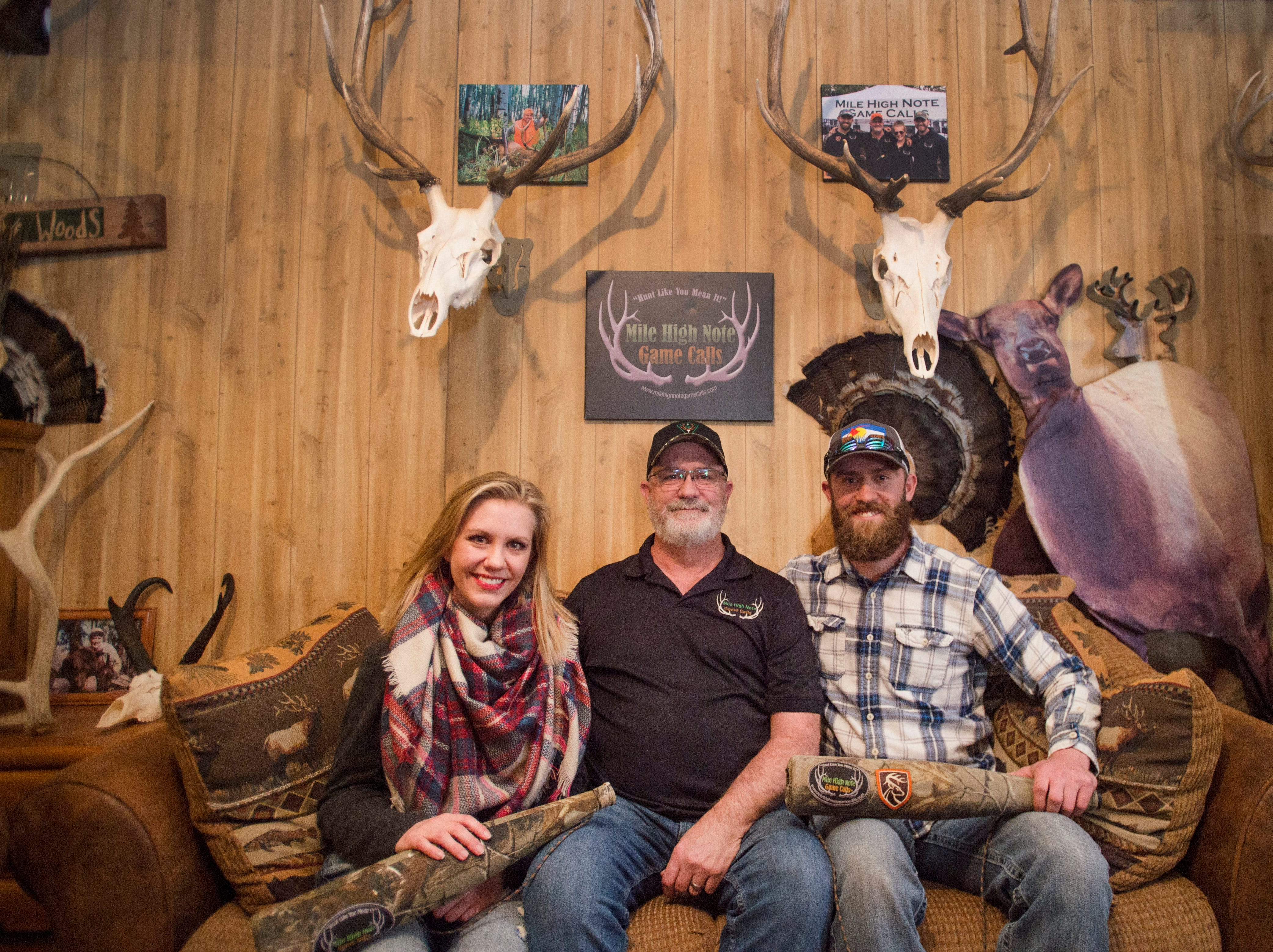 Tom Diesing, center, poses for a photo with his children, Jessi Slaten and Thomas Diesing at their home in Loveland on Wednesday, March 28, 2018. The family has won state and national titles for their ability to replicate elk calls.