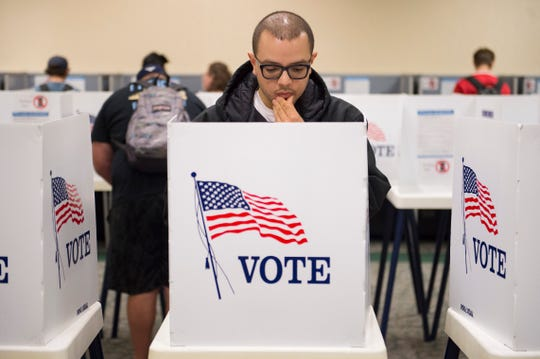 Matthew Moreno looks over his choices in the voting booth during early voting at CSU's Lory Student Center on Nov. 5, 2018.