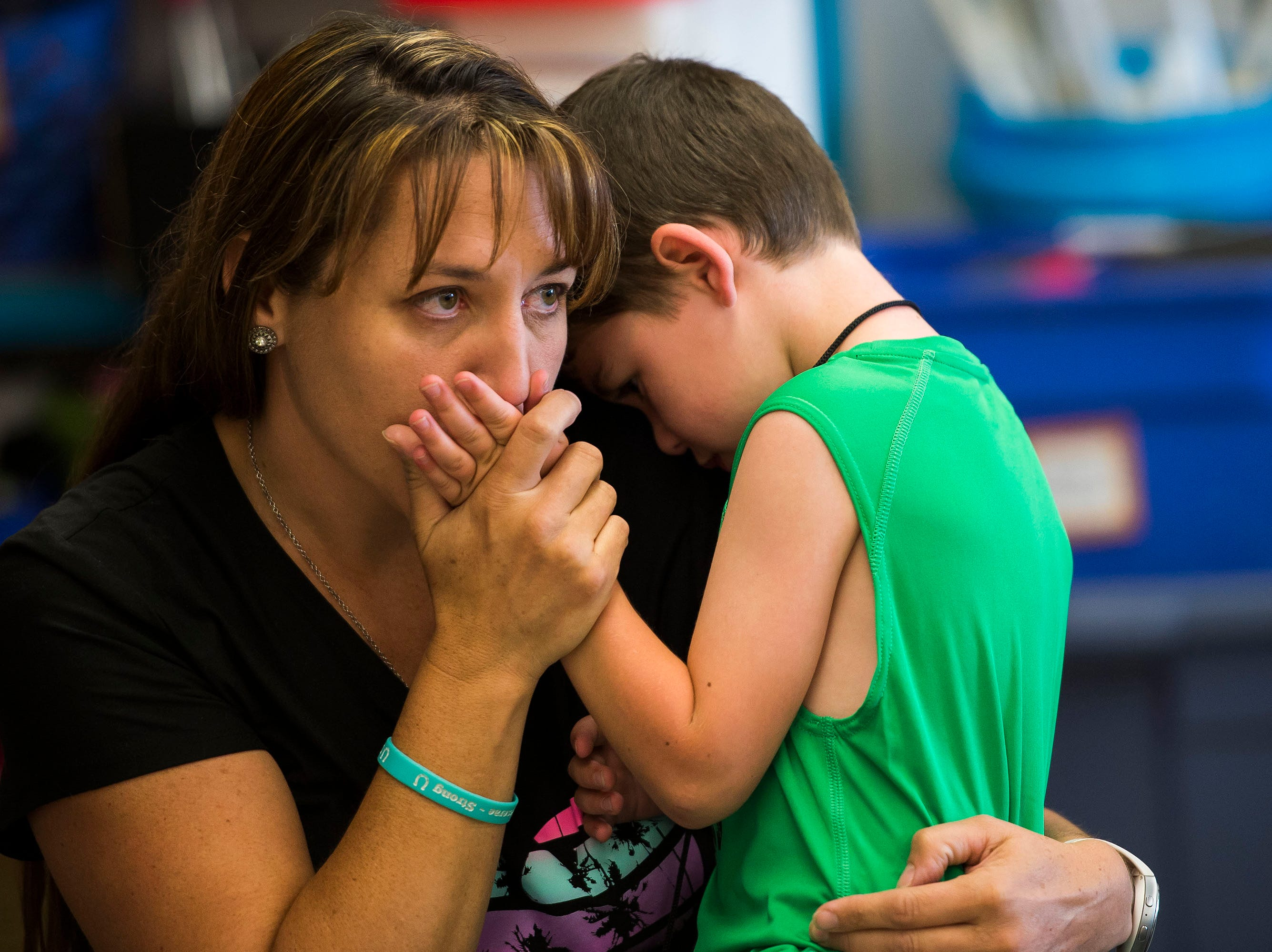 "Shannon Craig kisses her son Tucker's hand after his class read ""The Kissing Hand"" by Audrey Penn, during Tucker's first day of kindergarten in Kelly Hancock's class on Tuesday, Aug. 21, 2018, at Cache La Poudre Elementary School in Laporte, Colo."