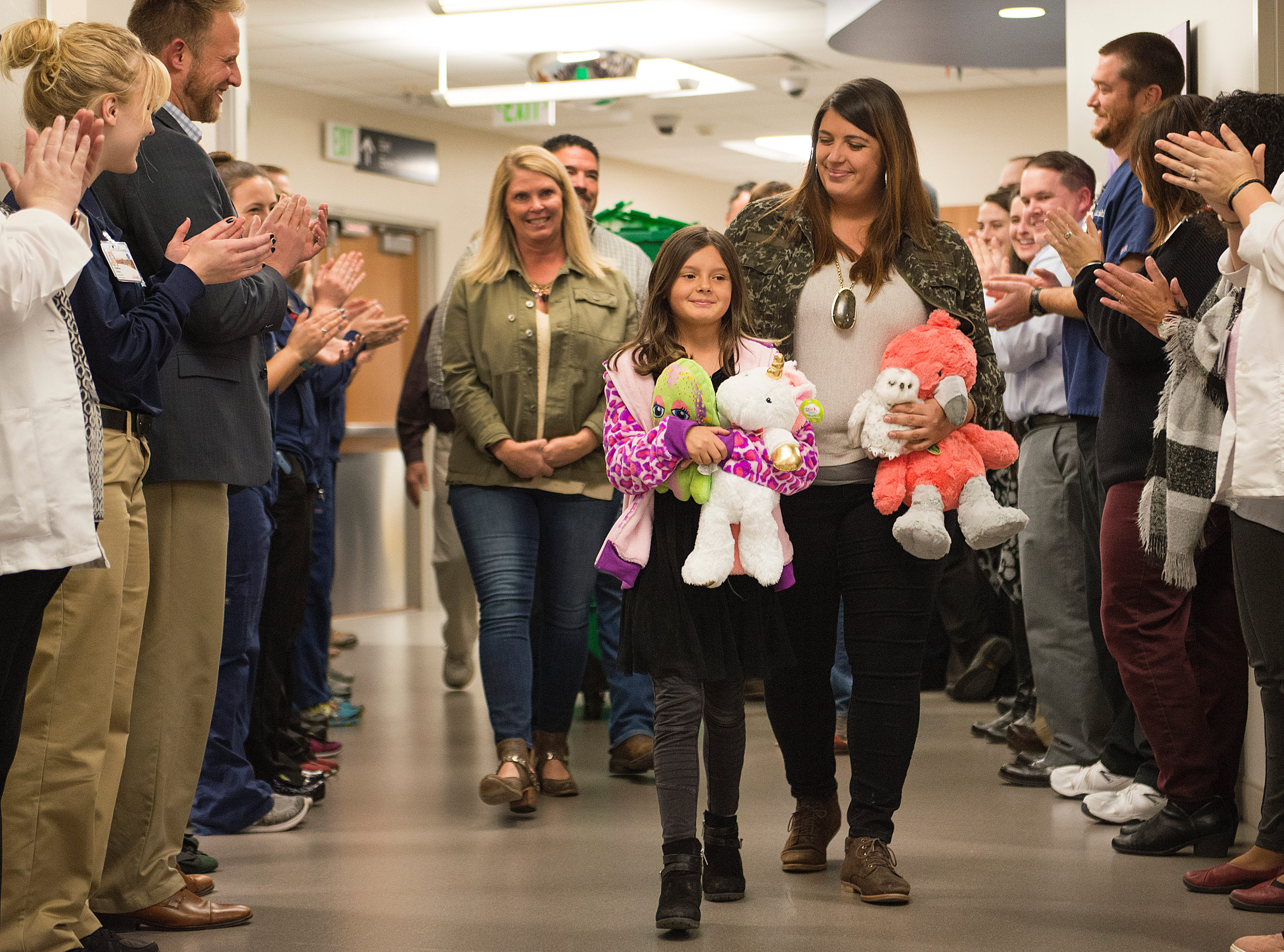 8-year-old Marlie Walker gets a warm welcome from emergency room staff as she delivers over 600 stuffed animals she collected for children experiencing a crisis at Poudre Valley Hospital on Monday, November 26, 2018. Walker was comforted by a stuffed animal given by an emergency room nurse after her father was killed in a motorcycle crash this year.