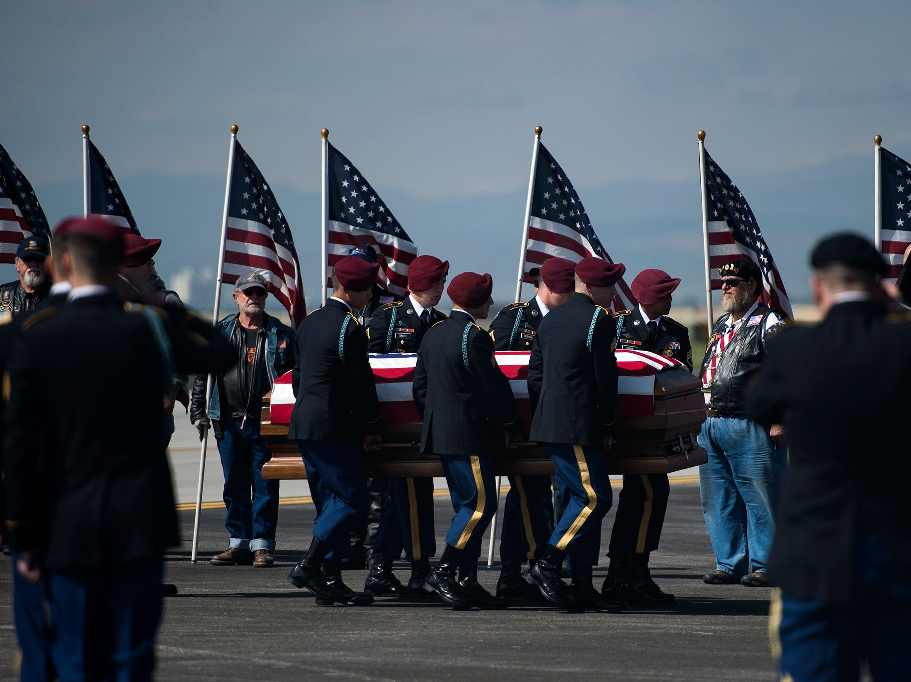 Fallen U.S. Army Specialist Gabriel Conde's body is carried to the hearse by honor guards before a procession to Longmont on Friday, May 11, 2018, at the Northern Colorado Regional Airport in Loveland, Colo.