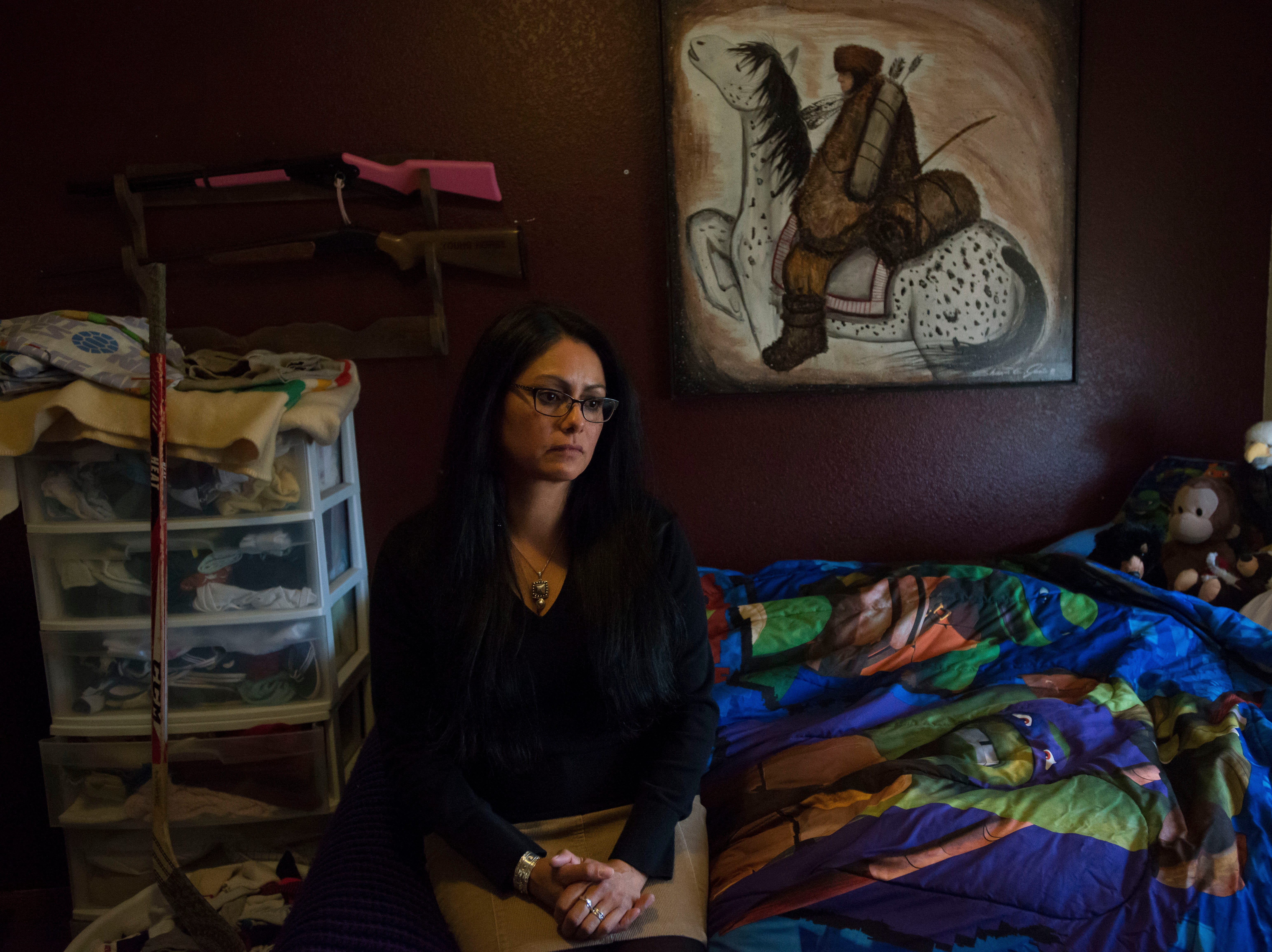 Lydia Lerma, the mother of the first victim who came forward in a child sexual assault case against Andrew Vanderwal, poses for a portrait in her child's bedroom on Tuesday, April 10, 2018, at her home in Fort Collins, Colo.