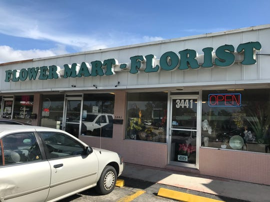 Two cars were shot at in front of the Flower Mart on Fowler Street Friday in Fort Myers.