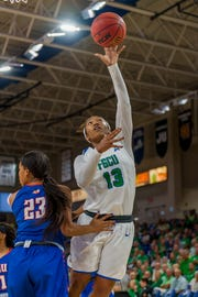 Kerstie Phills, pictured in FGCU's 99-68 home win over Florida Memorial on Nov. 12, 2018, has started six games this season.  She wears No. 13 in honor of her father, late former NBA player Bobby Phills, who died in a car crash in Charlotte, North Carolina, on Jan. 12, 2000.
