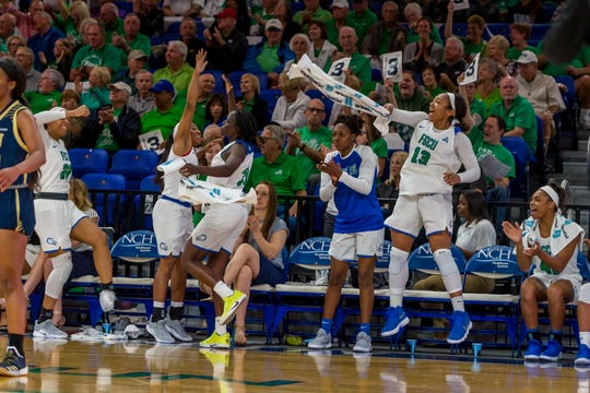 Kerstie Phills (#13) celebrates during FGCU's 100-58 home win over FIU on Nov. 16, 2018. Phills is the daughter of late former NBA player Bobby Phills, who died in a car crash in Charlotte, North Carolina, on Jan. 12, 2000.