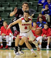 Lourdes Academy's Jack McKellips (5) beats Green Bay N.E.W. Lutheran's Lucas Bukowski to the baseline at the Kress Center on Friday.
