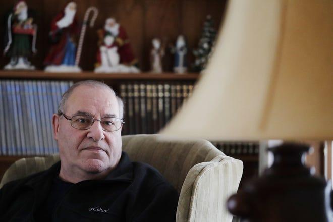 Mark Bentley sits in his living room on in De Pere.