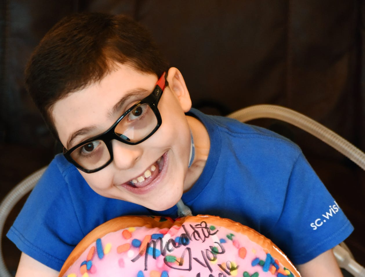 Cole Carroll holds a plush donut that he had signed by the cast of the Nickelodeon show Game Shakers during his trip to Los Angeles with Make-A-Wish South Carolina.