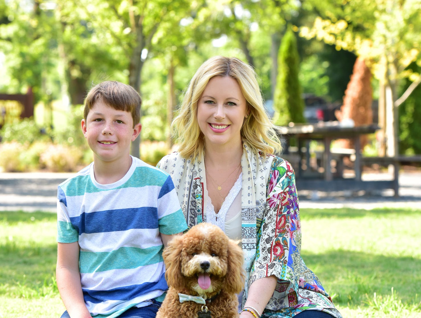 Jen Boshe, right, her son Caelan and their dog Bodhi.