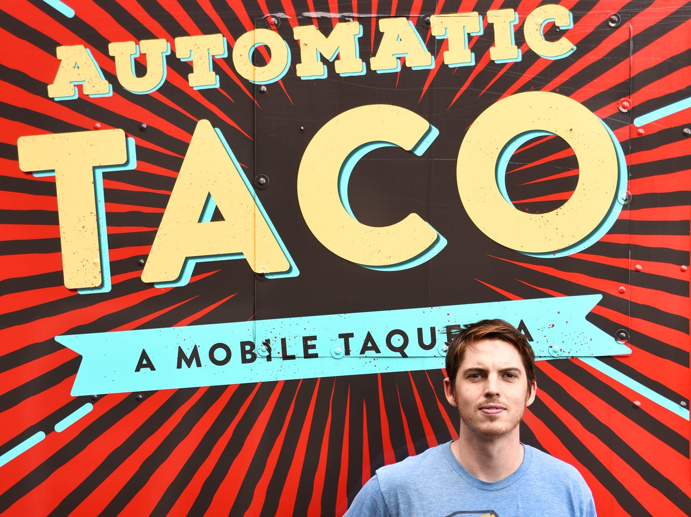Nick Thomas, owner of Automatic Taco, stands outside of the food truck where he operate his business.
