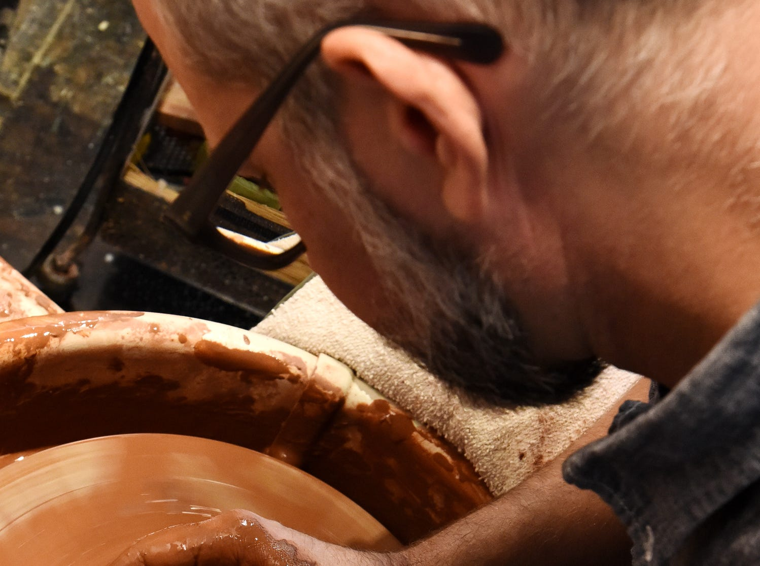 Darin Gehrke uses a potter's wheel at his studio in the West Village of Greenville.