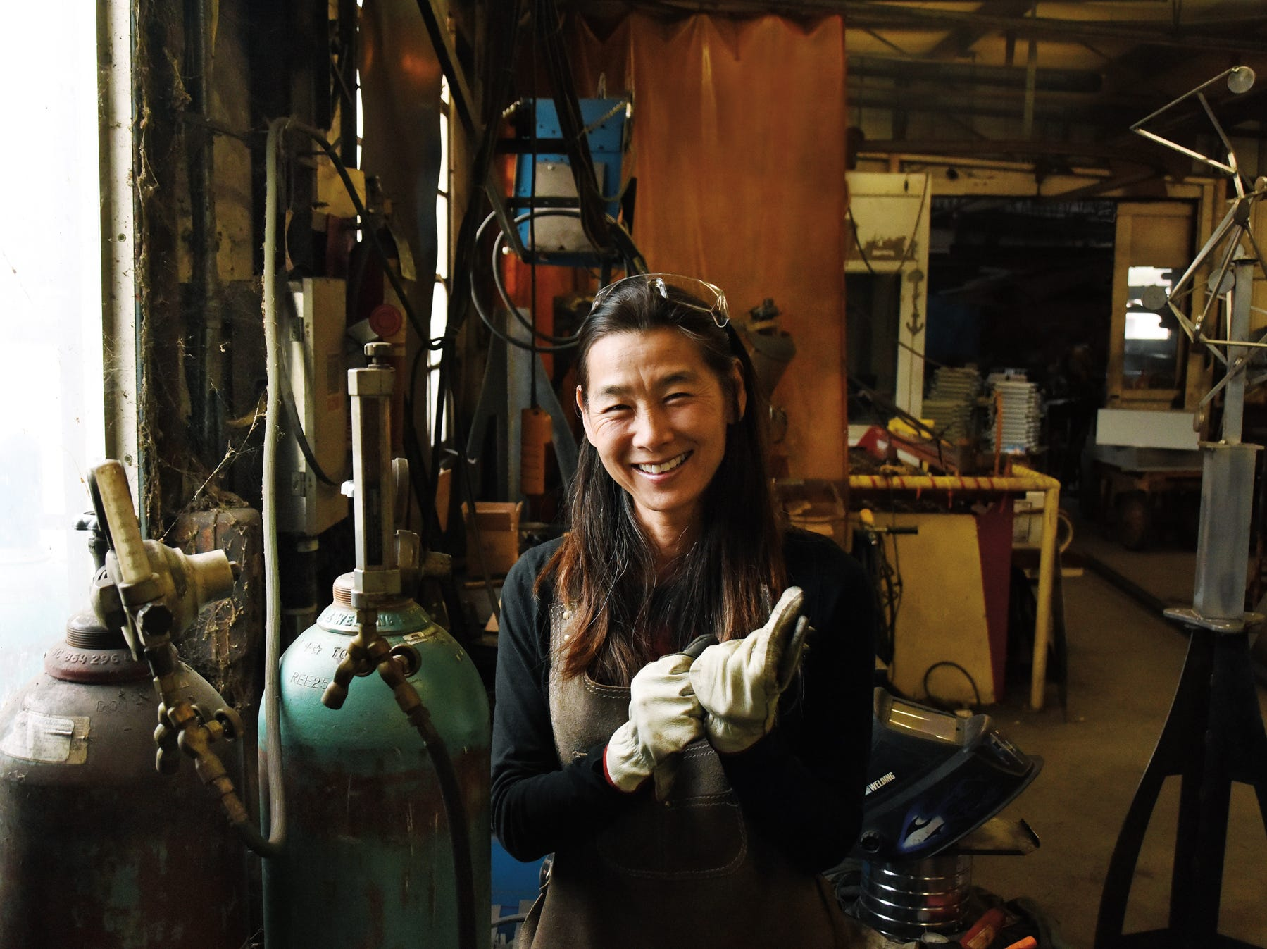 Yuri Tsuzuki in the shop where she does her metal work.