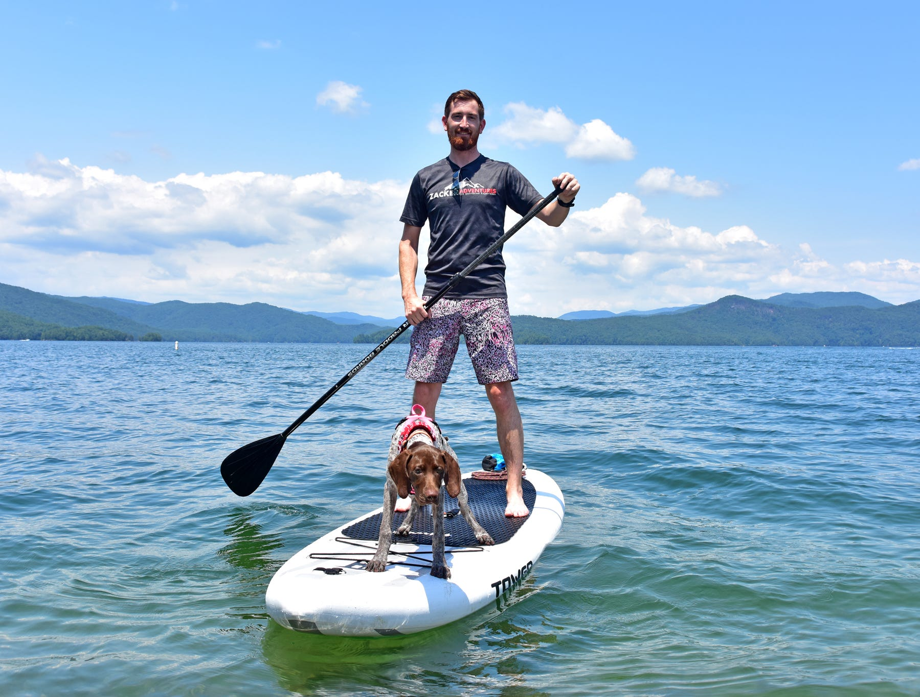 Stephen Townsend and his dog Maggie ride on a paddle board on Lake Jocassee.